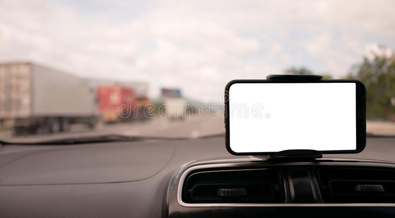 Smartphone on the front handle of the car with white screen stock image