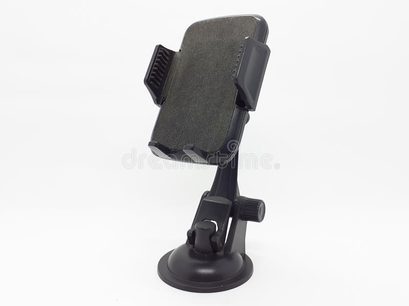 Smartphone or GPS device holder for car`s dashboard in white isolated background 01 royalty free stock photography