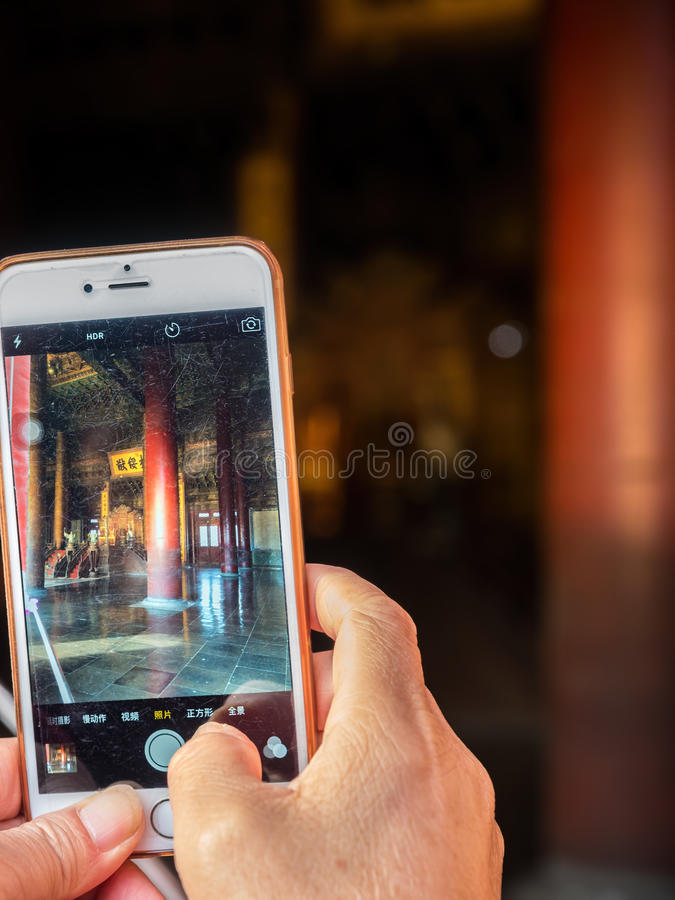 Smartphone at the Hall of Supreme Harmony Taihedian. Forbidden City Gu Gong, Palace Museum stock image