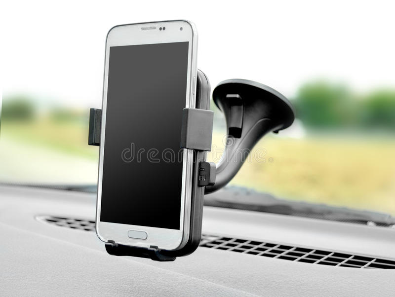 Smartphone holder in car. The smartphone in the automobile holder stock images
