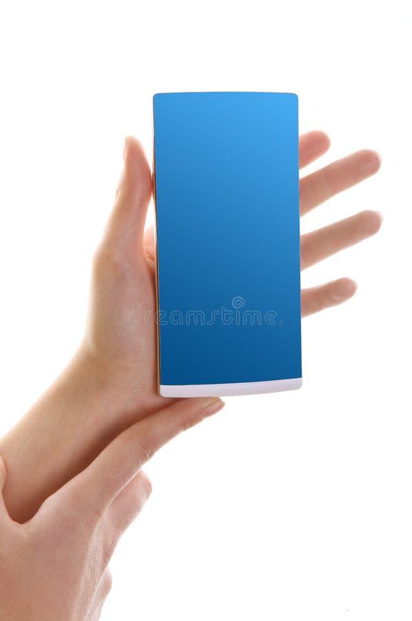 Smartphone i kvinnliga händer royaltyfri fotografi