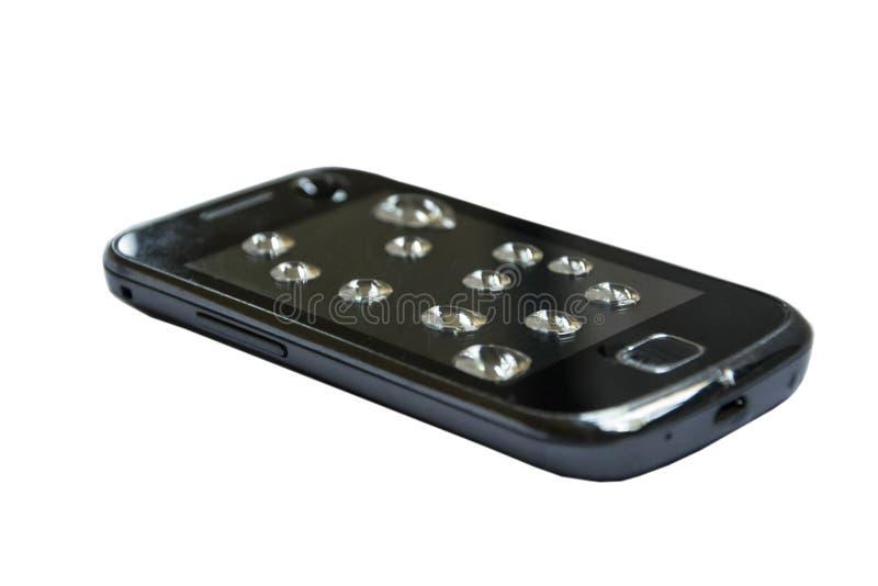 Smartphone impermeável com espirro da água no fundo branco foto de stock royalty free