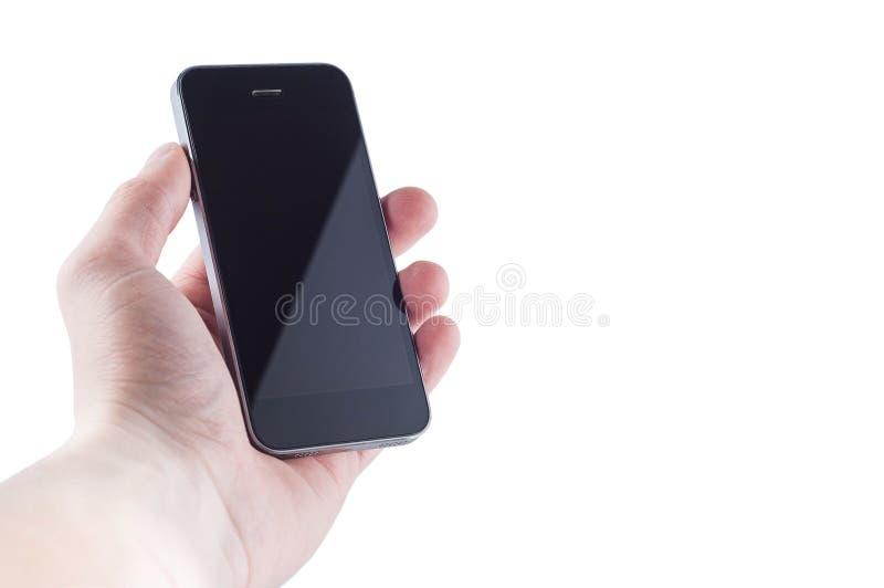 Smartphone innomado negro sin los botones con un resplandor en la pantalla a disposición en un aislante blanco del fondo imágenes de archivo libres de regalías