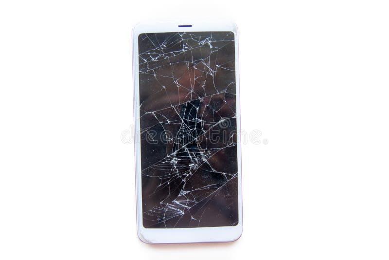 Smartphone móvil con la pantalla de cristal quebrada aislada en blanco texto de las FO del copyspace Concepto del servicio, de la fotografía de archivo