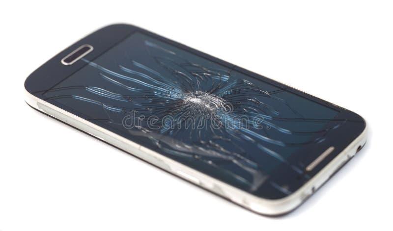 Smartphone móvil con la pantalla quebrada aislada en el backgroun blanco fotografía de archivo libre de regalías