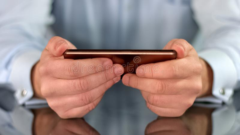 Smartphone in male hands closeup, business application, social networks, gadget. Stock photo royalty free stock photo