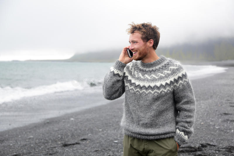 Smartphone Man Talking On Phone On Beach, Iceland Stock ...