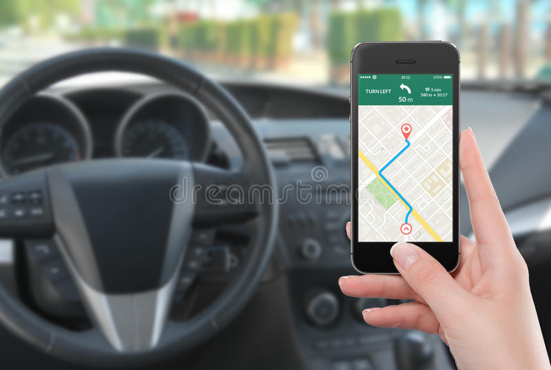 Smartphone with map gps navigation app on the screen in female h royalty free stock image