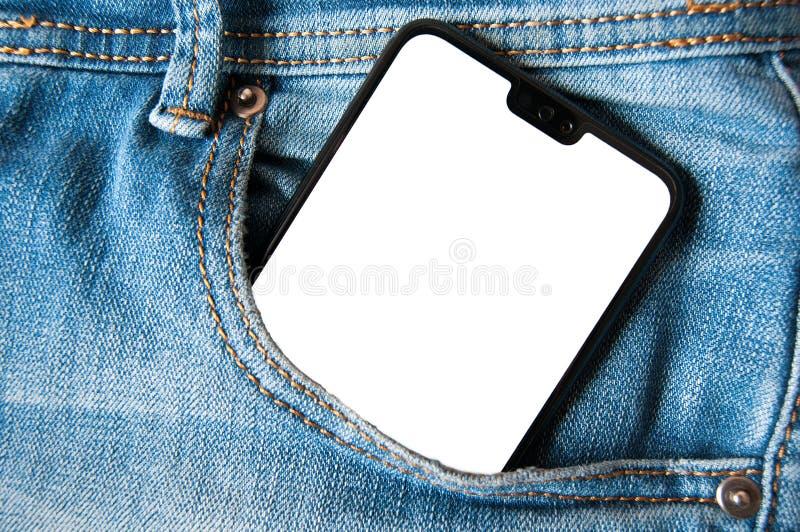 Smartphone med den vita skärmen i jeans för en grov bomullstvill stoppa i fickan royaltyfri bild