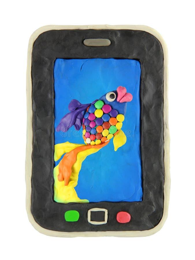 Smartphone med fiskbakgrund royaltyfria foton
