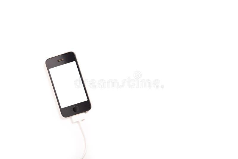 Smartphone med pluggad USB kabel royaltyfria foton