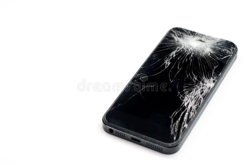 Smartphone mobile con lo schermo rotto isolato su backgroun bianco immagine stock