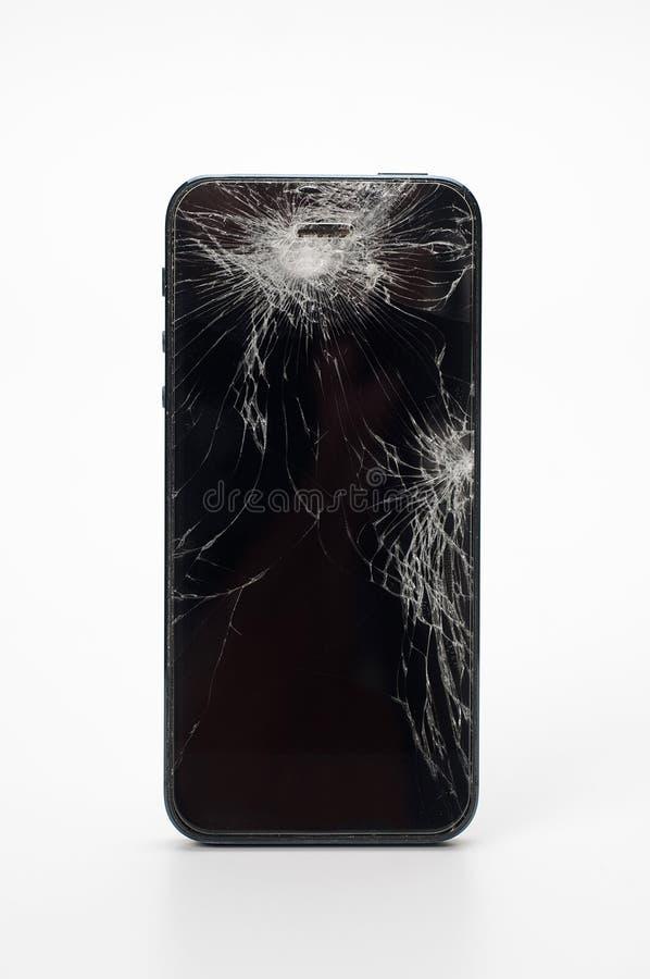 Smartphone mobile con lo schermo rotto isolato su backgroun bianco immagine stock libera da diritti