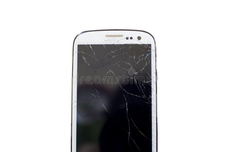 Smartphone mobile moderne avec l'écran cassé d'isolement sur le fond blanc images libres de droits
