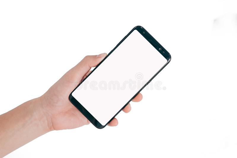 Smartphone Mock up,Hand holding blank white screen mobile phone isolated on white background with clipping path for stock photo