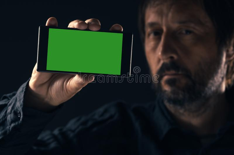 Smartphone mock up in male hand stock photo