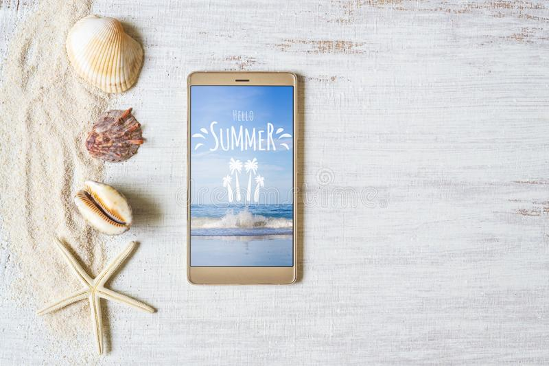 Smartphone mock up template for summer holiday. Summer vacation background. View from above. Flat lay with free space royalty free stock photo