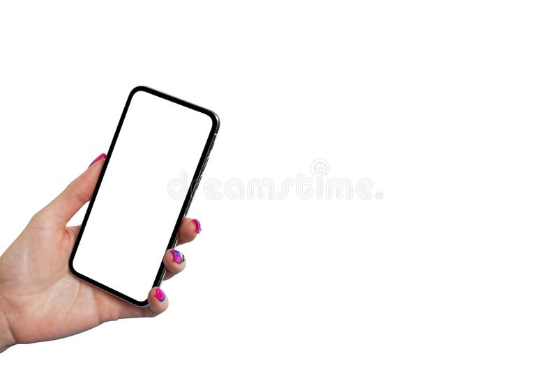 Smartphone mockup in woman hand isolated on white background. Modern frameless smartphone mock up with blank white screen. Empty s stock image