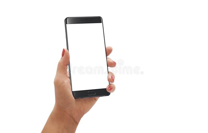Smartphone moderno del control de la mujer con el borde curvado con la pantalla blanca para la maqueta fotos de archivo