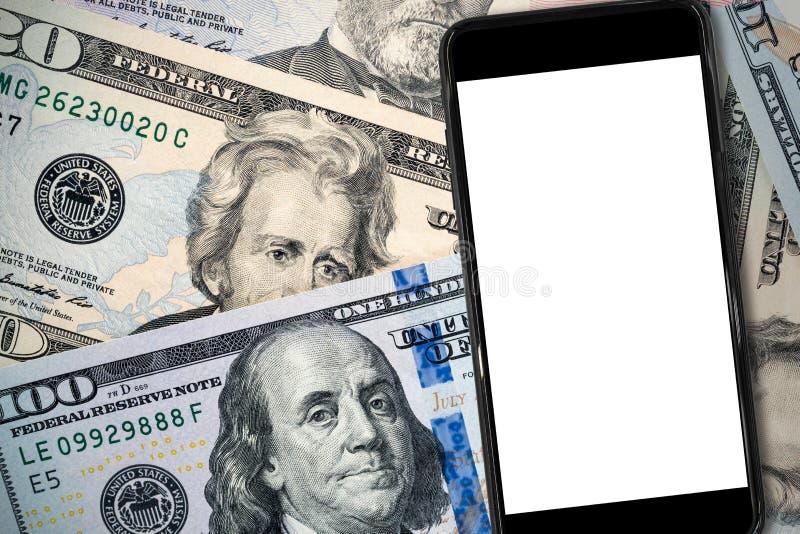 Smartphone nero su soldi del dollaro americano fotografia stock libera da diritti