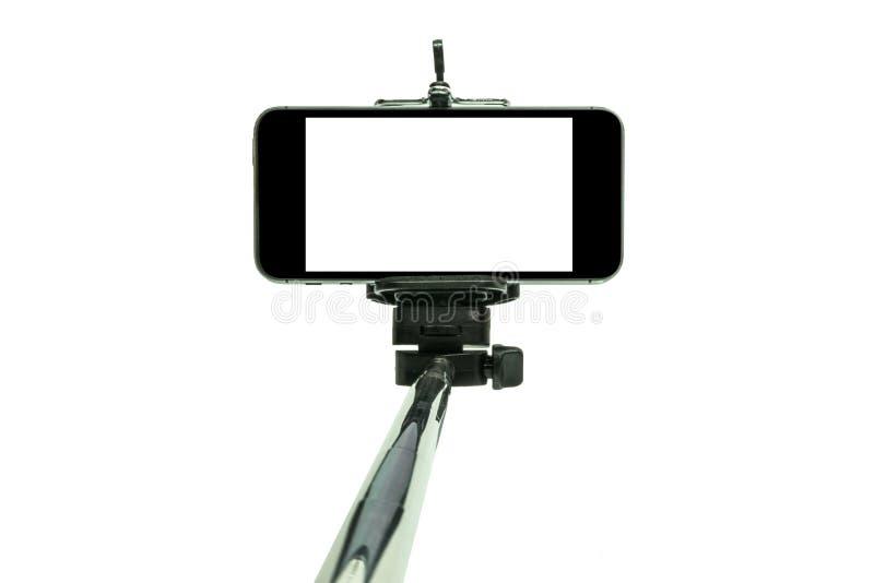 Smartphone på en selfiepinne sköt i studio 1 royaltyfri bild