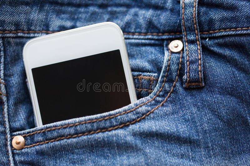 Smartphone in pocket of denim pants or jeans. Technology and communication concept - smartphone in pocket of denim pants or jeans stock images