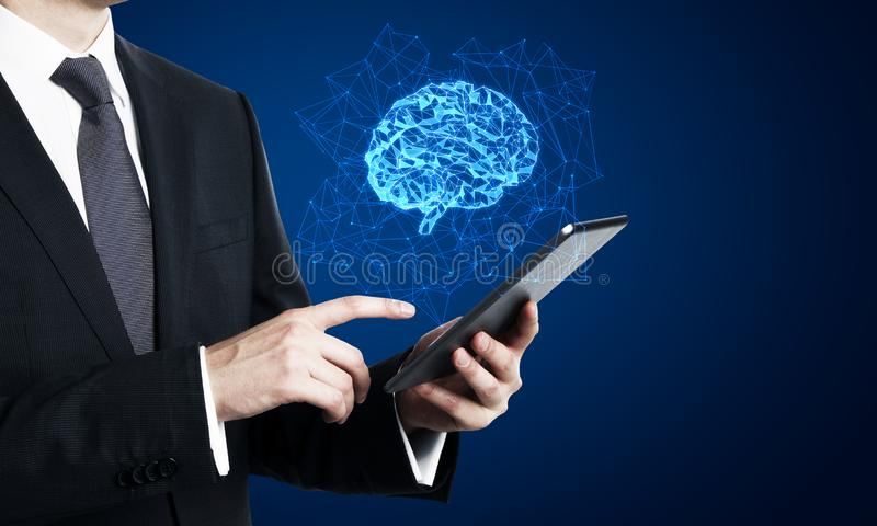 Smartphone with polygonal brain. Businessman using smartphone with creative glowing polygonal brain on blue background. AI and future concept stock image