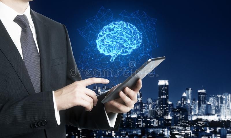 Smartphone with polygonal brain. Businessman using smartphone with creative glowing polygonal brain on night city background. AI and future concept. Double royalty free stock photo
