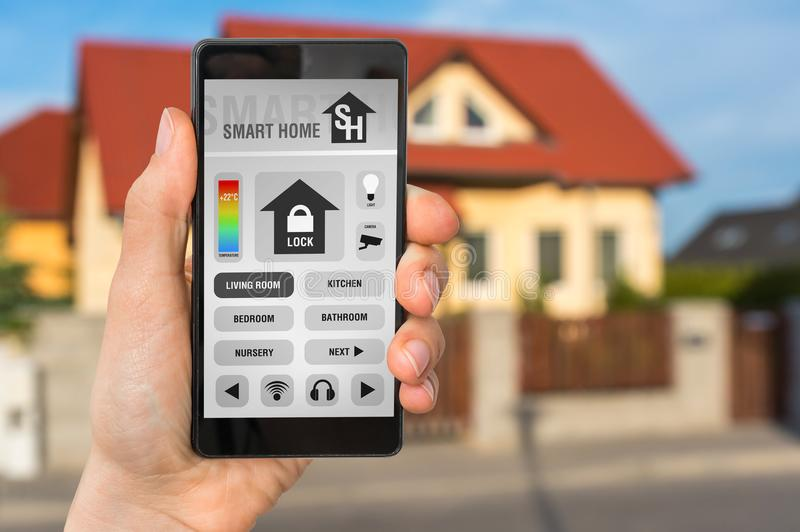 Smartphone with remote smart home control system royalty free stock image