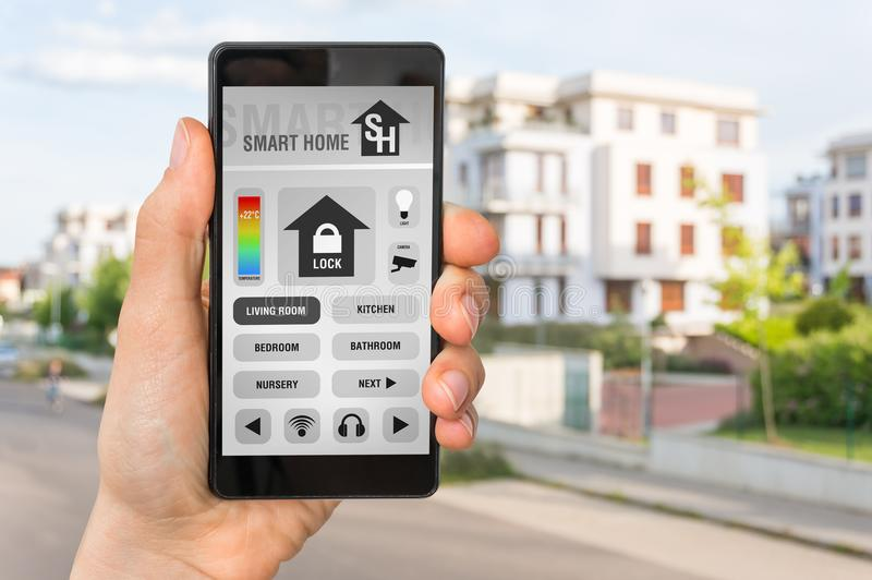 Smartphone with remote smart home control system stock image