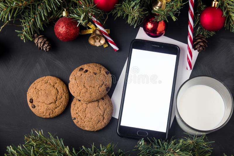 Smartphone with screen on christmas background.  royalty free stock image