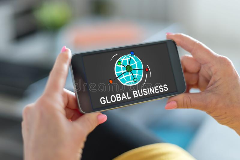 Global business concept on a smartphone. Smartphone screen displaying a global business concept stock photography