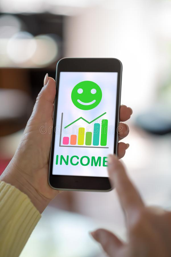 Income growth concept on a smartphone. Smartphone screen displaying an income growth concept stock photos