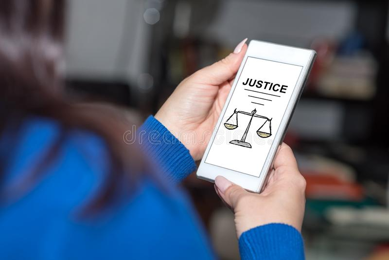 Justice concept on a smartphone stock photos