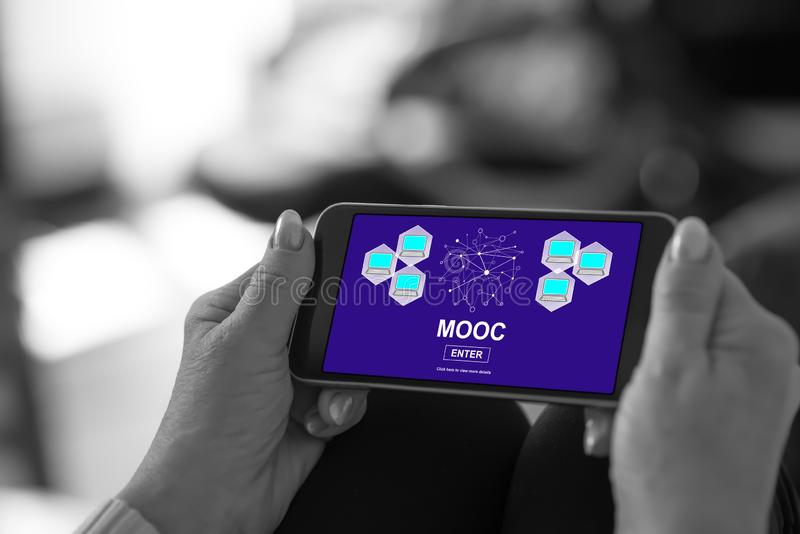 Mooc concept on a smartphone. Smartphone screen displaying a mooc concept royalty free stock photos