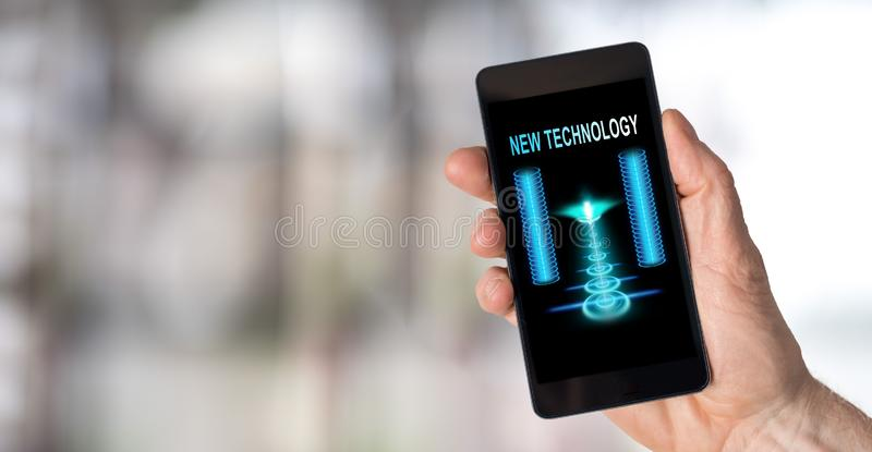 New technology concept on a smartphone. Smartphone screen displaying a new technology concept royalty free stock photography