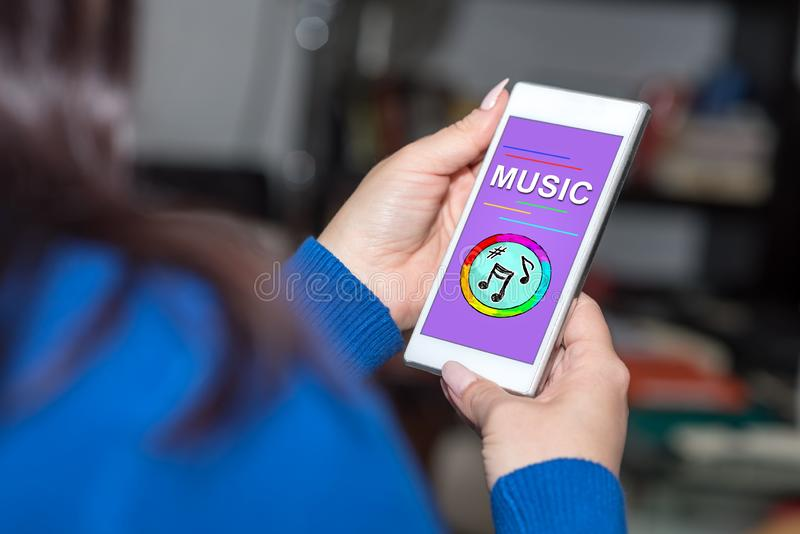 Online music concept on a smartphone. Smartphone screen displaying an online musioncept royalty free stock images