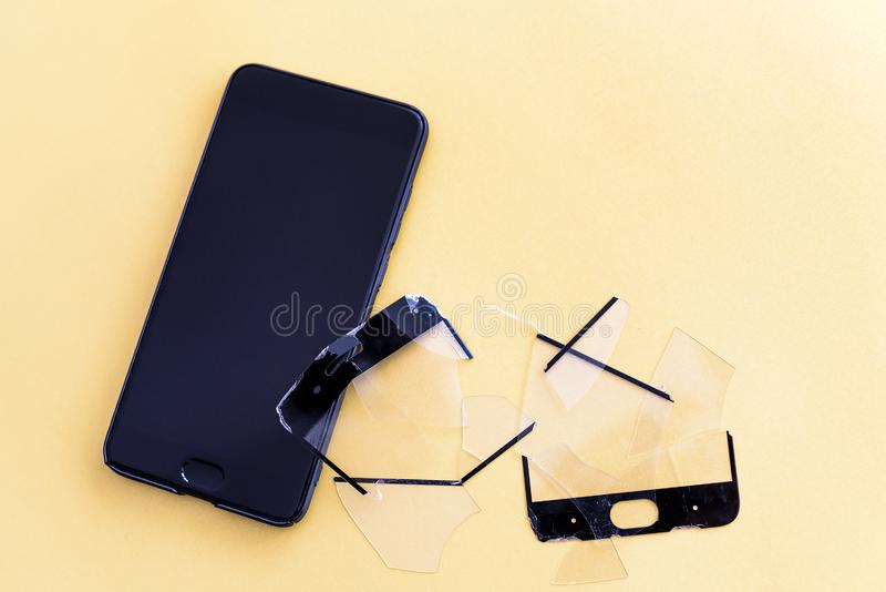 Smartphone with screen protect glass cover in colored background. Broken screen protector and smart mobile phone. Smartphone with screen protect glass cover in stock photos