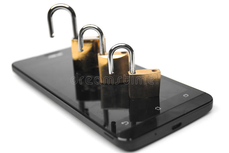 Smartphone security breach. Open security locks on a smartphone / Smartphone security breach stock images