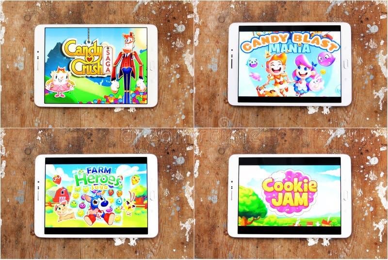 Smartphone-Spiele Süßigkeits-Zerstampfungs-Saga, Plätzchen-Marmelade, Süßigkeits-Explosions-Manie, Bauernhof-Held-Saga lizenzfreie stockfotografie