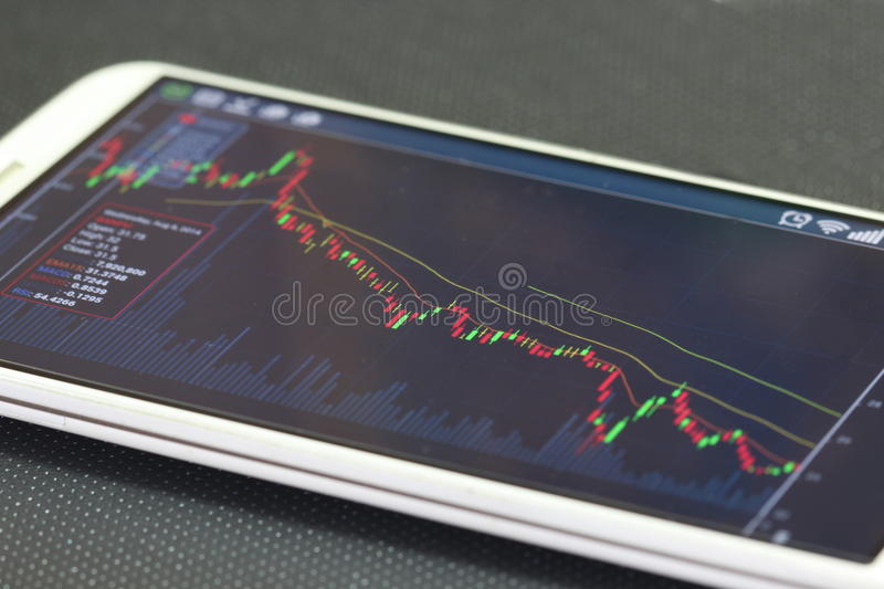 Smartphone and stock chart, investment. Smartphone and stock chart investment trading background stock photos