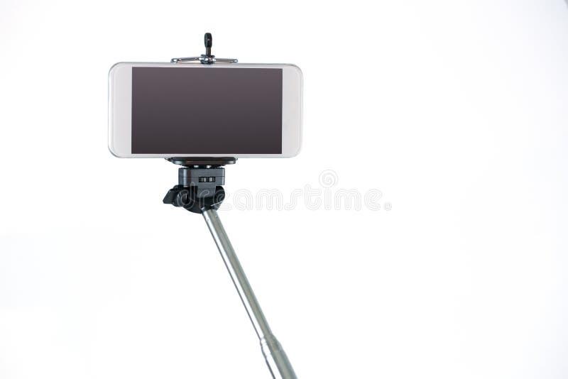 Smartphone sur un bâton de selfie photos libres de droits