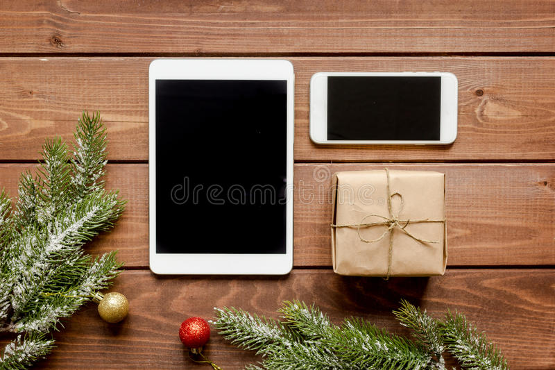 Smartphone, tablet, shopping for new year online wooden table. Smartphone, tablet, shopping for new year online on wooden table top view stock image