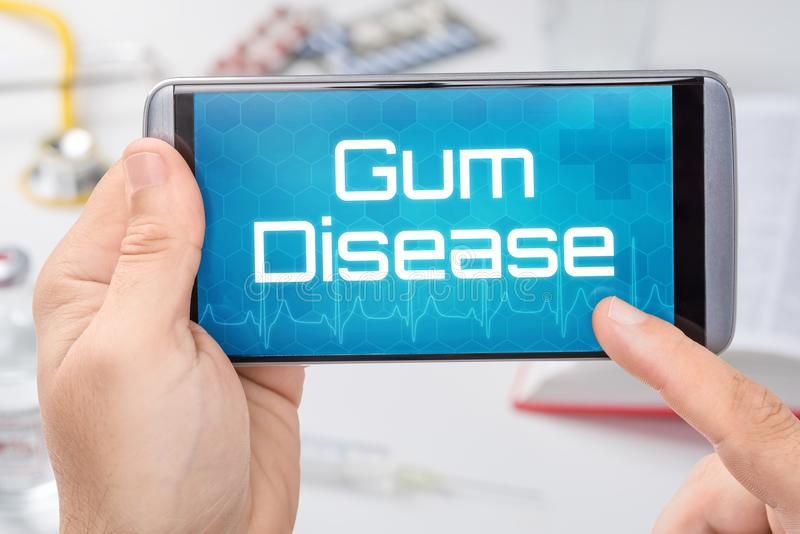 Smartphone with the text Gum Disease. On the display stock photos