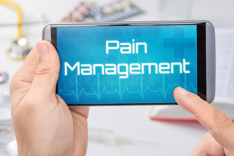 Smartphone with the text Pain Management stock photo