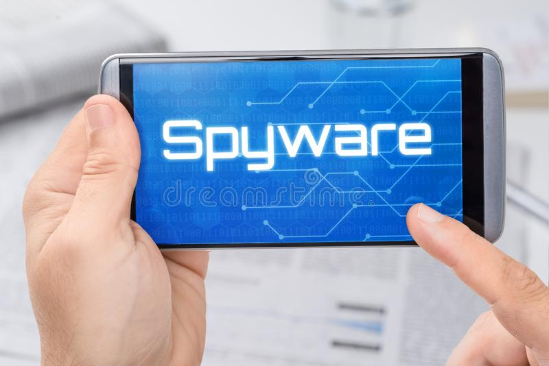 Smartphone with the text Spyware royalty free stock photos