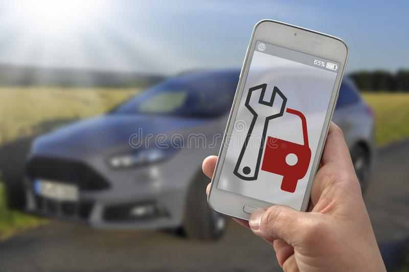 Smartphone with tools and breakdown service royalty free stock image
