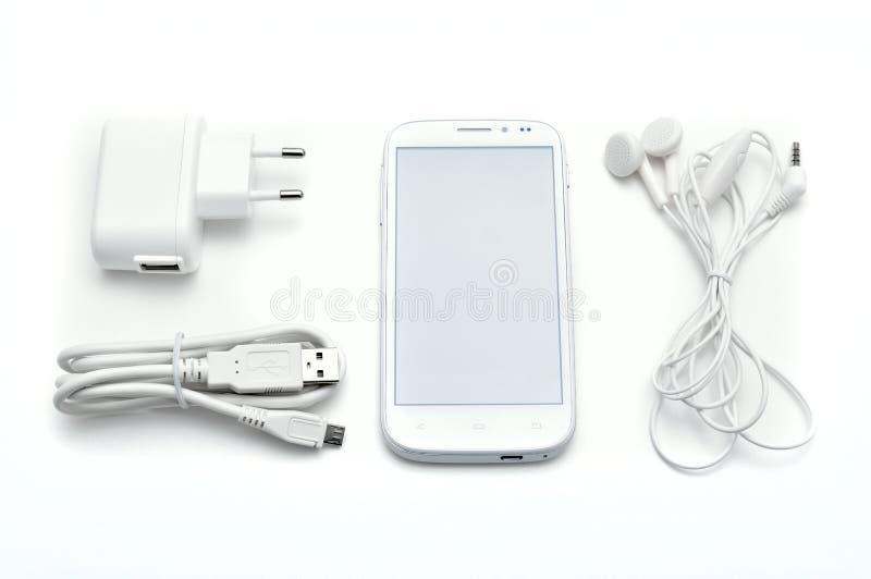 Smartphone ustawiający z akcesoriami obraz stock
