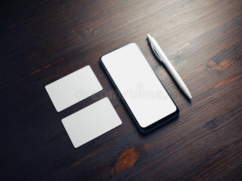 Smartphone, Visitenkarten, Stift stockbild