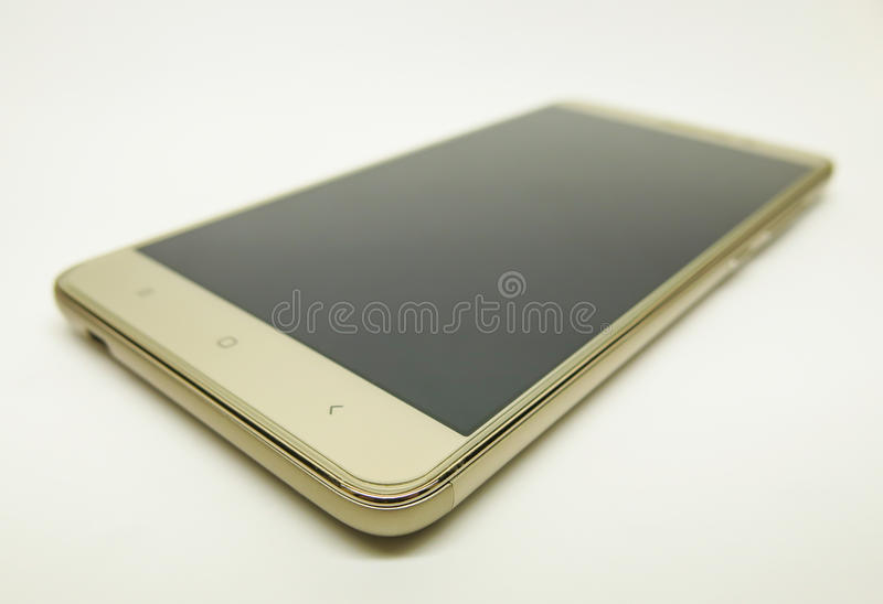 Smartphone on a white background. Smartphone in a golden package on a white background royalty free stock images